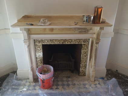 stripped old paint from mantel